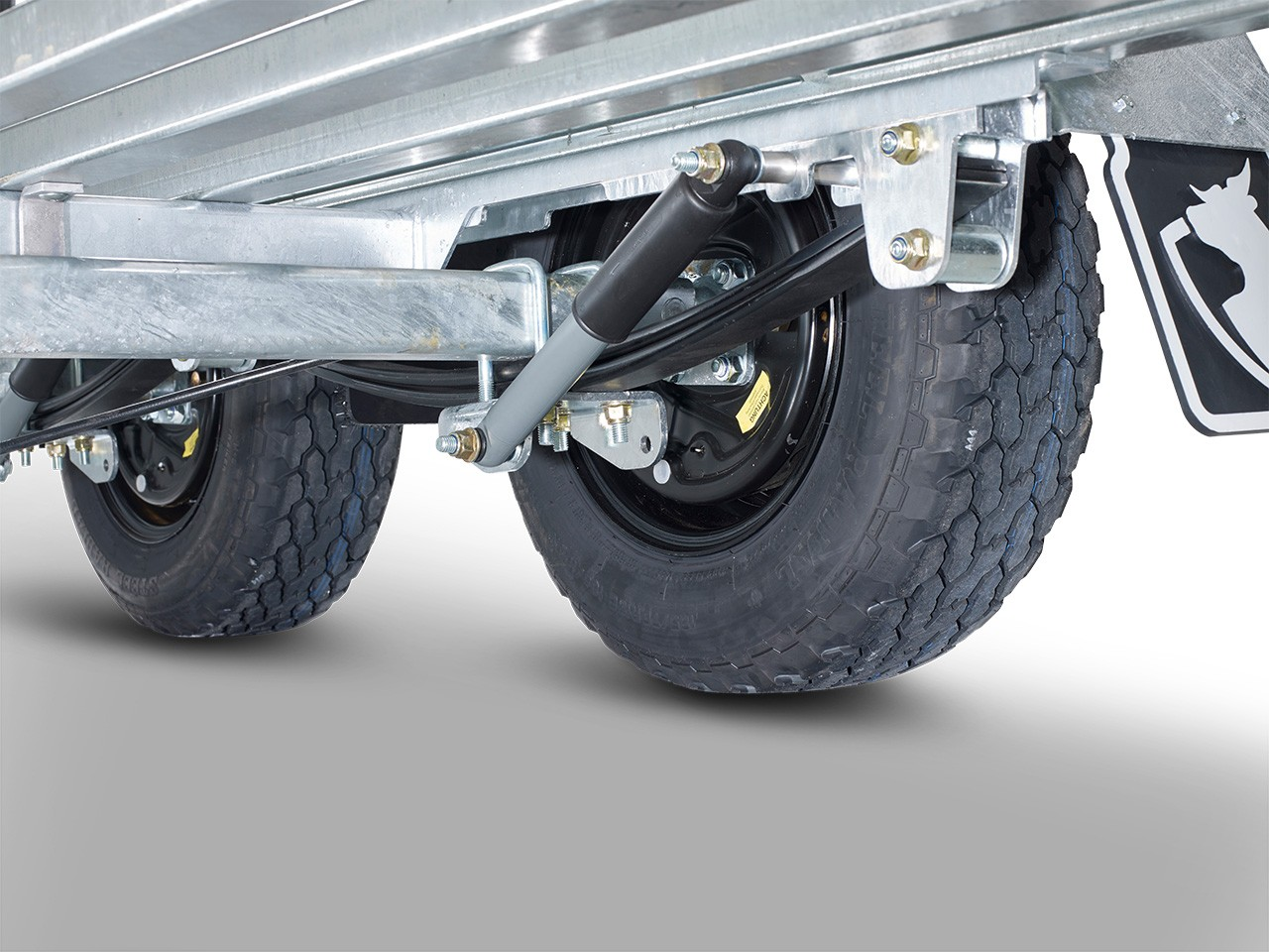 Parabolic suspension with shock absorbers